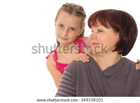 Adult mom and adorable daughter, portrait. Closeup - Isolated on white background - stock photo