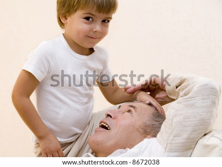 Adult senior play about with his grandchild - stock photo