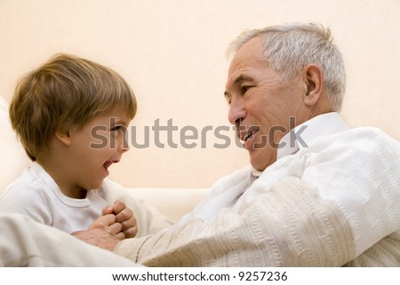 Adult senior play about with his grandchild 2 - stock photo