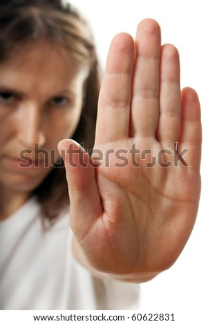 Adult shy women hand gesture stop sign hiding face - stock photo
