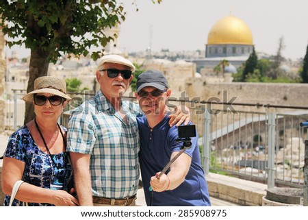 adult son traveling with parents - stock photo