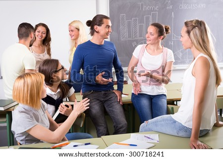 Adult students having a break during their training session in a classroom - stock photo
