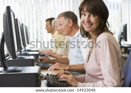 Adult students in a computer lab - stock photo
