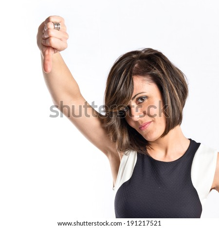 Adult woman doing a bad signal over white background  - stock photo