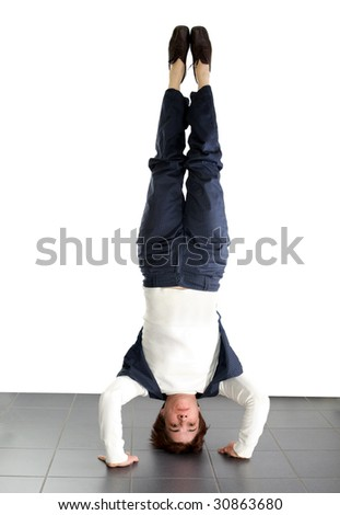adult woman doing a headstand - stock photo
