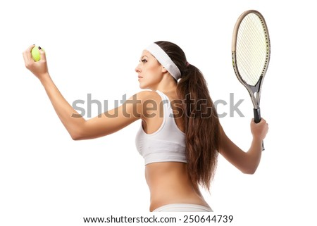 Adult woman playing tennis and showing her back. Studio shot over white. - stock photo