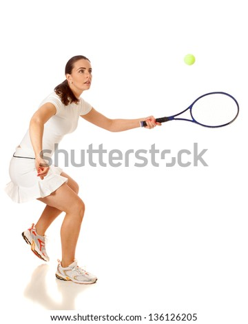 Adult woman playing tennis. Studio shot over white. - stock photo