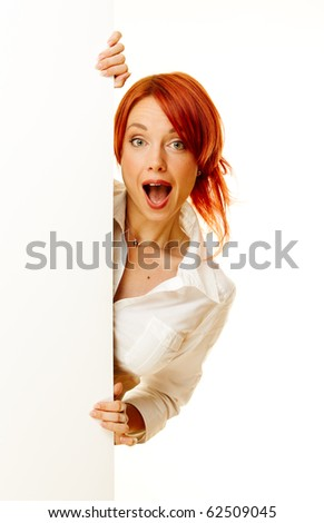 adult woman showing with a blank billboard - stock photo