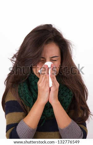 Adult woman sneezing in tissue, isolated on white background. - stock photo
