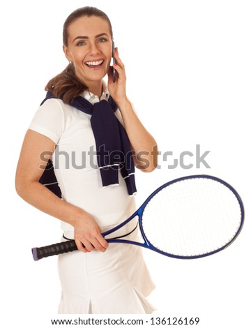 Adult woman tennis player with mobile phone. Studio shot over white.