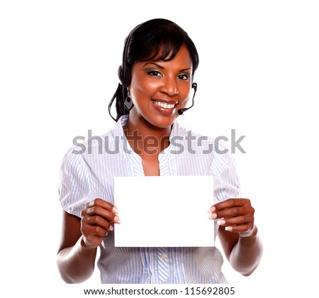 Adult woman wearing headphones looking at you and holding white card on isolated background - copyspace - stock photo