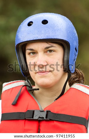 Adult woman wearing typical water sport outfit - stock photo