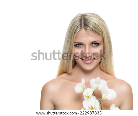 Adult woman with beautiful face and white flowers. Skin care concept. - stock photo