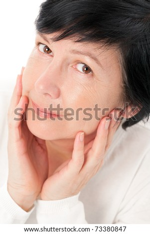 Adult woman with hands on face