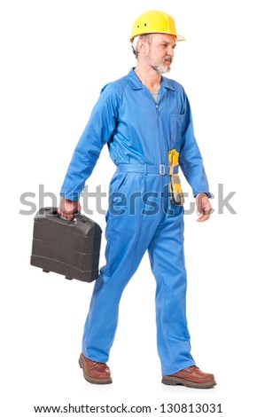 Adult worker in a uniform with toolbox isolated on white background - stock photo