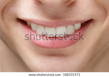 adult young man smile, after orthodontic treatment with braces - stock photo