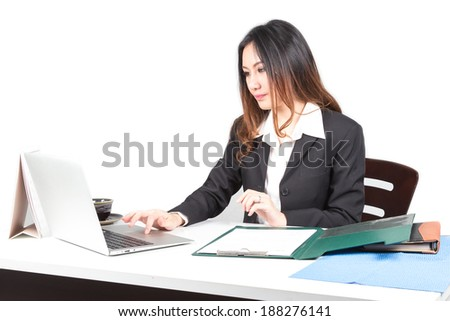Adult young pretty business woman working at her office