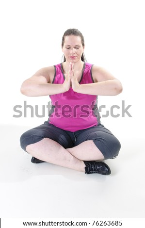 Adults are overweight woman with black hair with sports clothing and makes gymnastic exercises and sports, in front of white background.