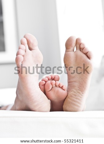 Adults och Childrens sole of feets - stock photo
