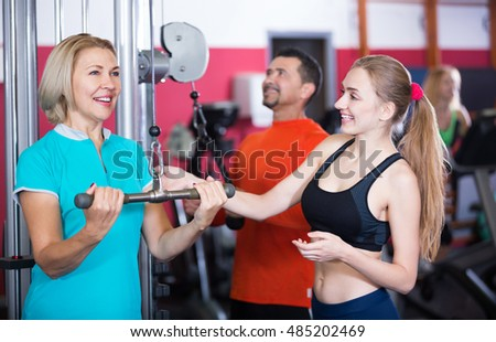 Adults of different age training in gym-hall
