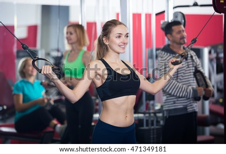 Adults of different age training in gym together