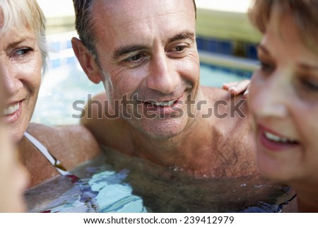 Adults Relaxing in Pool