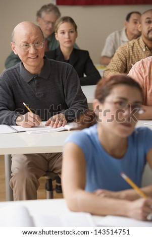 Adults taking a class - stock photo