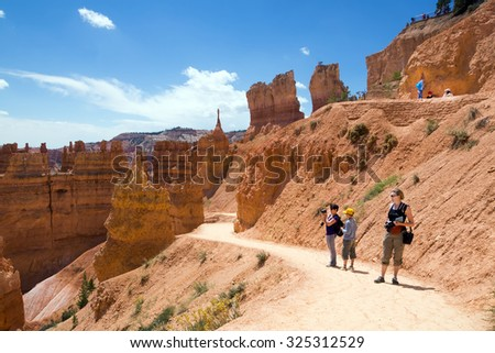 Adults with children on the trail. Bryce Canyon National Park, Utah, USA - stock photo