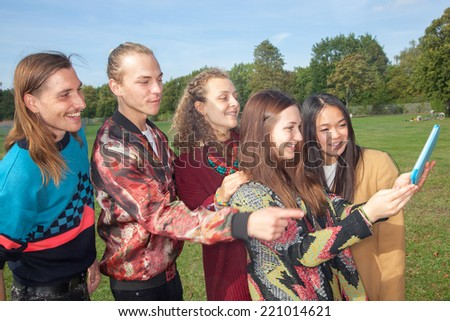 Adults young people make Selfie in the park