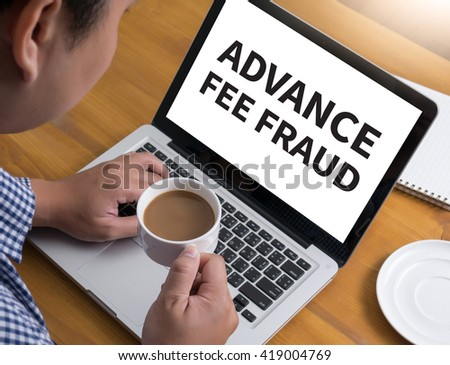 ADVANCE-FEE FRAUD Businessman at work. Close-up top view of man working on laptop while sitting at the wooden desk , coffee - stock photo