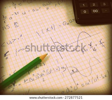 Advanced physics and maths notes (handwriting) - stock photo