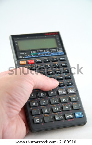 Advanced Scientific Calculator Isolated on White Background with Hand - stock photo