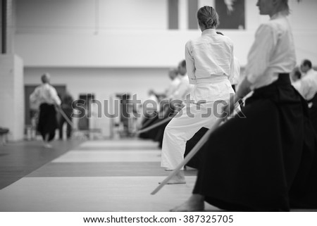 Advanced students and beginners practicing aikido together - stock photo