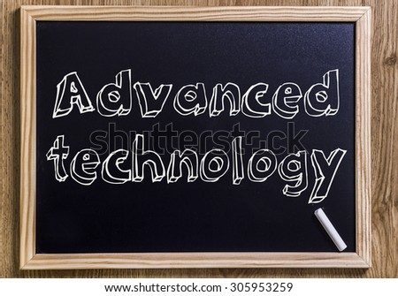 Advanced technology - New chalkboard with outlined text - on wood - stock photo