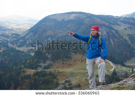 advanture man with backpack hiking on mountain forest