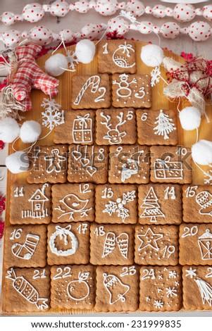 advent calendar, Christmas handmade gingerbread painted icing - stock photo