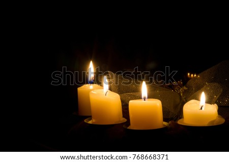advent candleholder with four burning candles