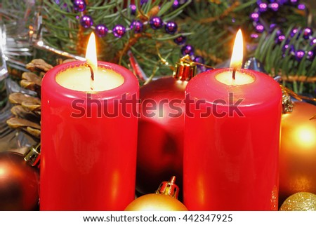 Advent candles with fir green and Christmas decoration - stock photo