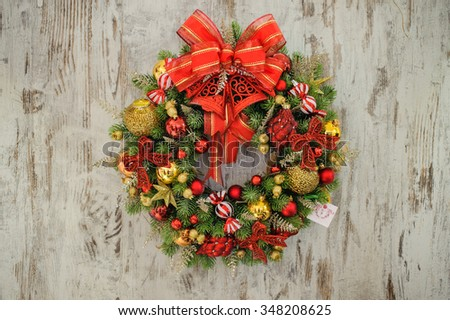 Advent Christmas wreath on the wooden background