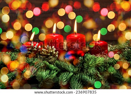 advent decoration with burning candles and wonderful lights. selective focus, vintage style toned picture. holidays background - stock photo