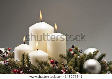 Advent wreath with burning candles for the Christmas time - stock photo