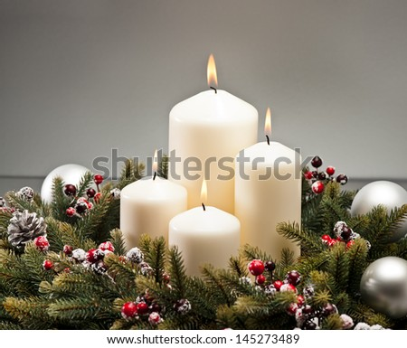 Advent wreath with burning candles for the pre Christmas time - stock photo