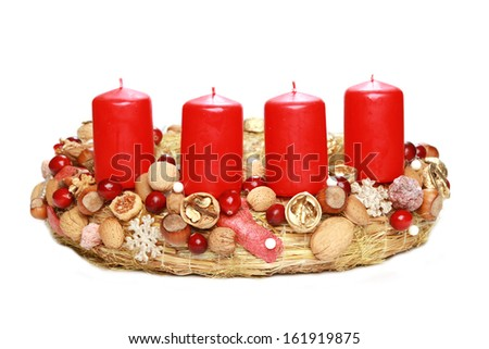 Advent wreath with red candles isolated on white.  - stock photo