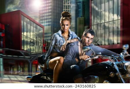 Adventure. A Couple Riding A Motorcycle - stock photo