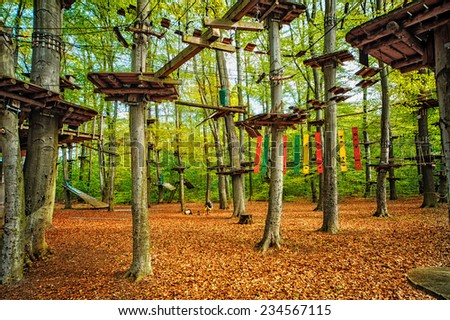 adventure climbing high wire park - stock photo