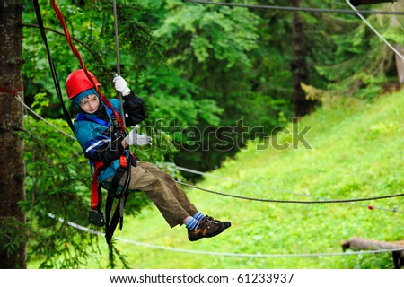 stock photo adventure climbing high wire park people on course in mountain helmet and safety equipment 61233937 tree climbing stock images, royalty free images & vectors Sexy Climbing Harness at gsmx.co