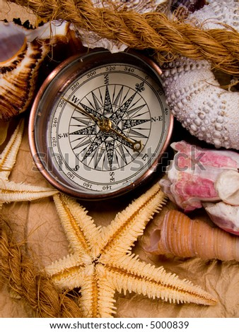 Adventure decoration with compass - stock photo