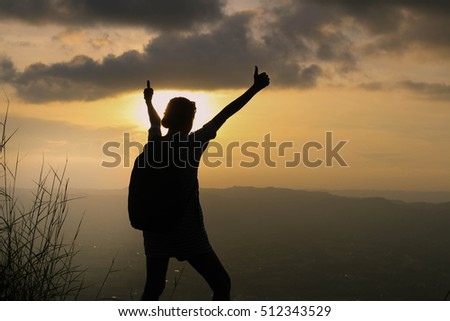 adventure lover woman standing on top of a mountain with the sun set background of the great holiday get away from business life