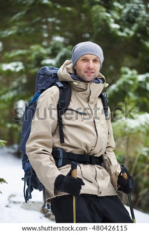 Adventure man hiking wilderness mountain with backpack, outdoor lifestyle survival vacation.