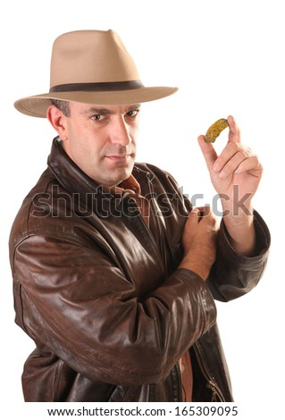 Adventurer treasure hunter with gold nugget - stock photo